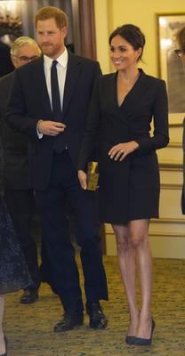 So stylish: Meghan in the black double-breasted tuxedo dress at the Hamilton musical in August