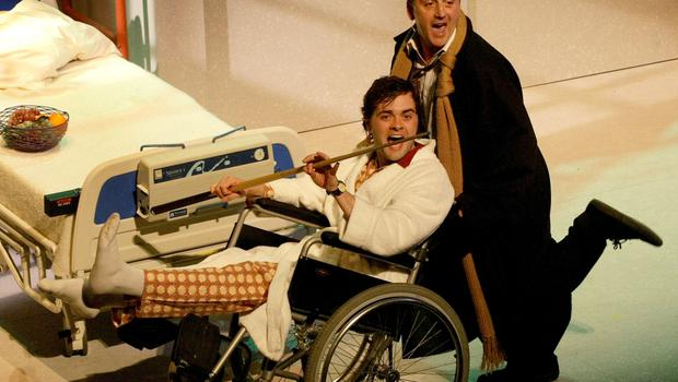 Alex Higgins played by Paddy Jenkins visits George Best played by Aidan O'Neill in the play Dancing Shoes