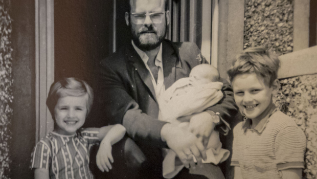 Alex's dad Alexander Henry Knight, holding a baby Alex, with sister Lorraine and brother Christopher