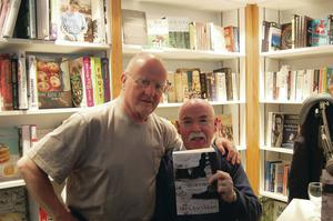 Folk lore: Paul shows off his new novel to Christy Moore