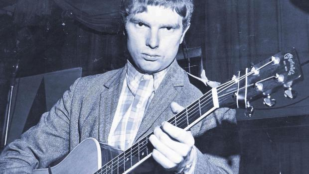 Van with guitar in hand back in the day