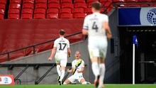 Centre stage: Oxford United's Mark Sykes (centre) celebrates scoring at Wembley