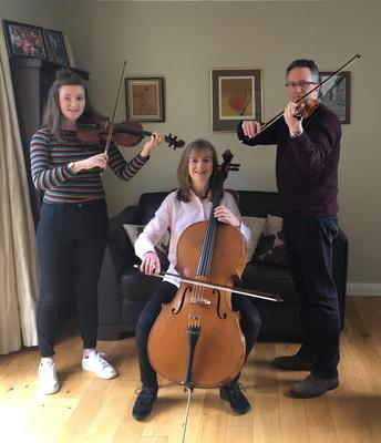 Jonathan Griffin and Morag Stewart performing with their daughter Susie
