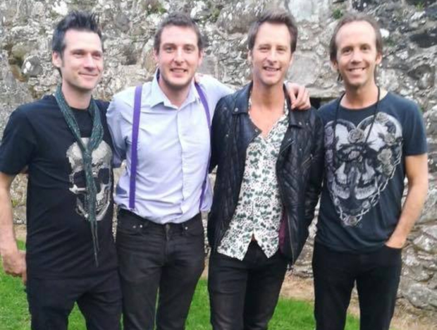 Rock on: Logan (second from left) with Chesney Hawkes (second from right) and Chesney's other bandmates before going on stage at Dergfest