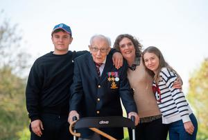 Proud family: Captain Tom Moore with (from left) grandson Benji, daughter Hannah Ingram-Moore and granddaughter Georgia at his home in Marston Moretaine