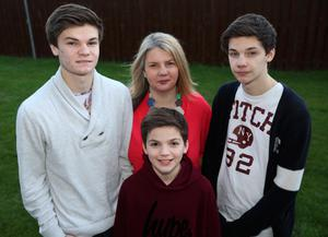 Hard workers: Karen Ireland with (from left) her sons Jesse, Teo and Korey