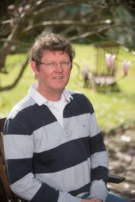 Battling on: Dr Cameron Imrie in his garden in Londonderry