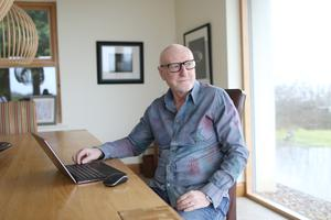 Jim relaxes at home, where he is currently writing another book