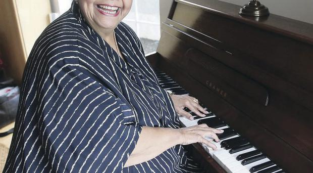 Candy Devine on her piano