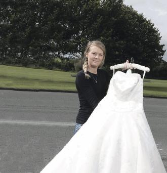 Mandie proudly displays her wedding dress