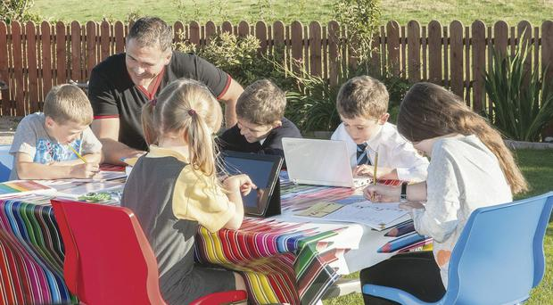 Happy pupils: David helping children at the homework club