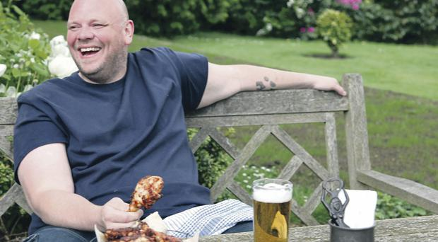 Dining out: Tom Kerridge relaxes in the garden of his award-winning pub