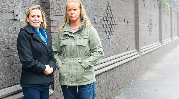 Shared hope: Jackie Upton, a Protestant and Seanna O'Hara (right), a Catholic, at the peace wall in Bryson Street, Belfast