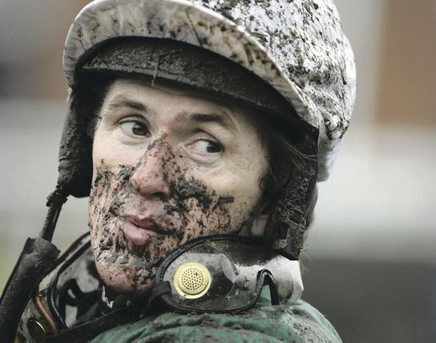 Tony McCoy, spattered with mud from the course