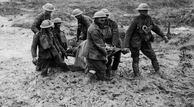 Men of war: soldiers remove an injured man from the battlefield