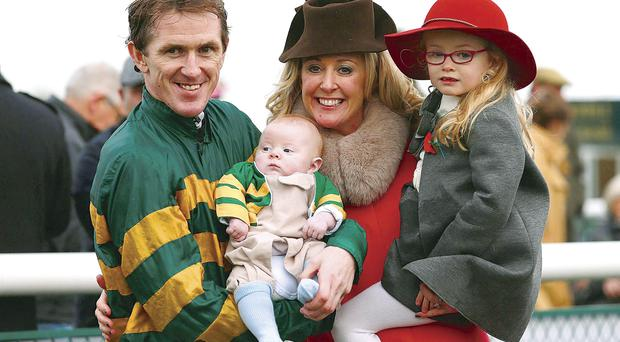 Victory smile: Tony McCoy with wife Chanelle, daughter Eve and son Archie after his historic 4,000th win last week
