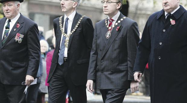 Lord Mayor Mairtin O Muilleoir (second left) attends the Royal British Legion's Armistice Day service