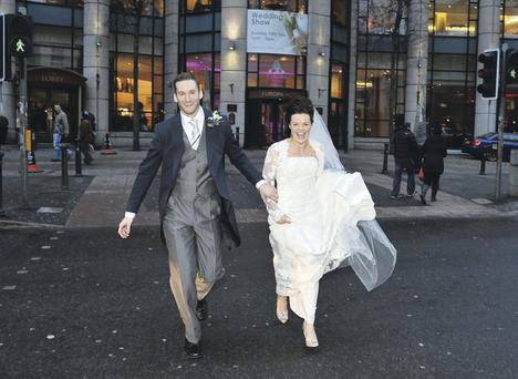 Marital bliss: Deborah Maguire and husband Tim Cook on their wedding day outside the Europa