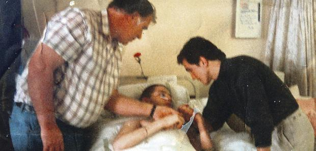 Stephen in hospital, with his dad Idris and Barry McGuigan