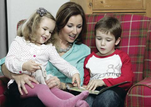 Special bond: Claire McCollum reading to her children Samuel and Rosa. Below, the classic tale of Little Red Riding Hood