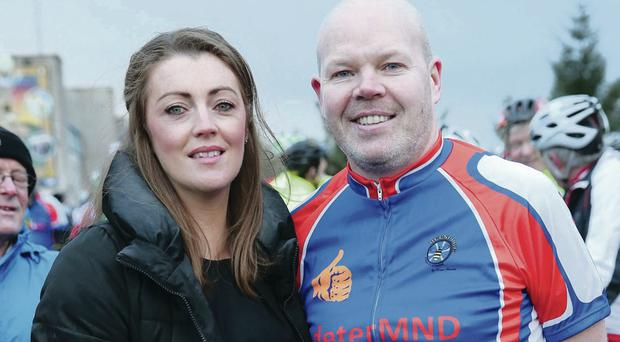 Good cause: Anto Finnegan with his wife Alison at the start of a sponsored cycle last weekend between Belfast and Dublin