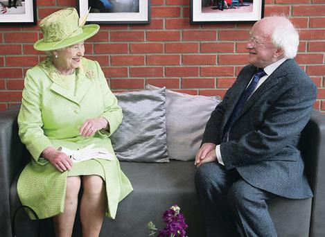 The Queen meets Irish president Michael D Higgins at the Lyric Theatre in Belfast