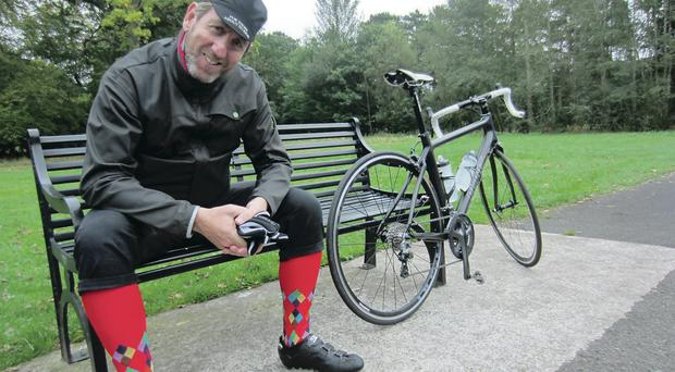 Michael Smiley with his bike in Ormeau Park, Belfast