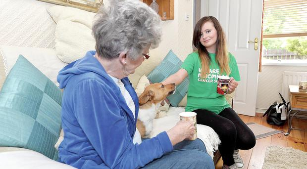 Tea-time treat: Abigail Lennox (right), at work as a volunteer for the Macmillan Cancer charity