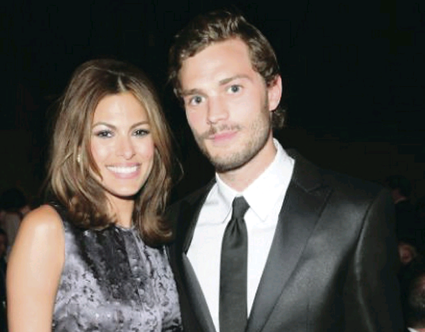 Football fan: Hollywood star Jamie Dornan, pictured with actress Eva Mendes, follows Bangor FC