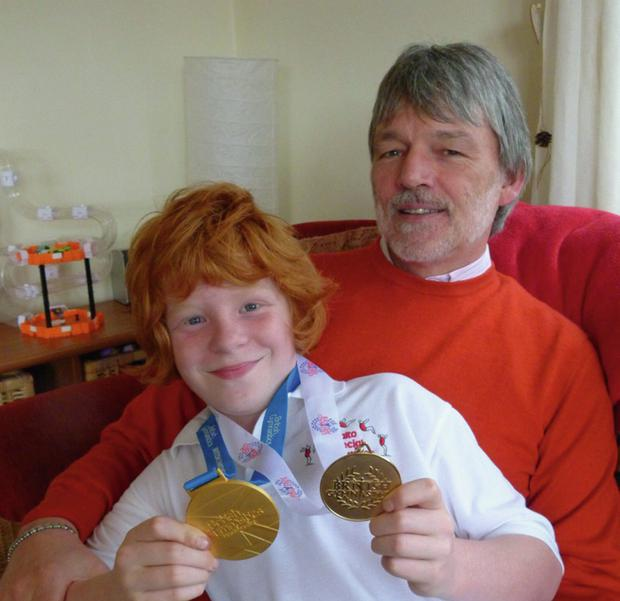 Gold rush: Jonathan, with his dad David McCartney, is hoping to add to his medal tally this weekend