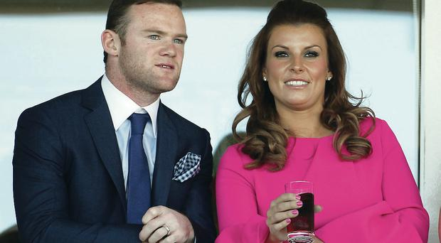 Morale boost: England's Wayne Rooney can be consoled over his team's defeats by wife Colleen