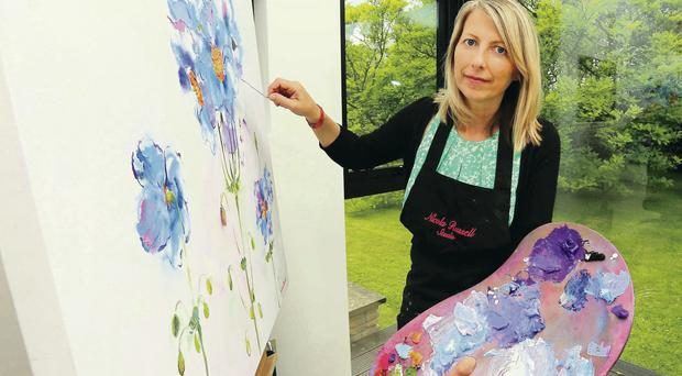 The big picture: Nicola Russell, who has been diagnosed with secondary cancer, painting in her home studio