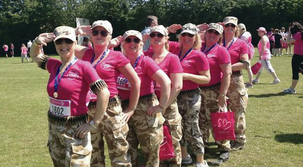 Standing to attention with a group of Action Cancer supporters at the annual Race for Life charity run