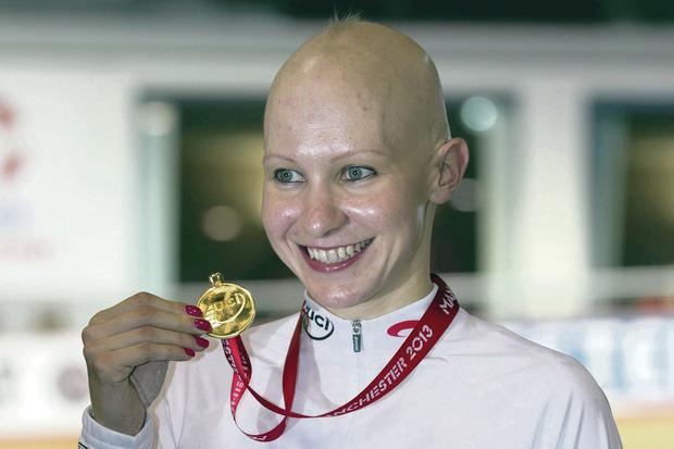 On track: Joanna Rowsell with one of her medals