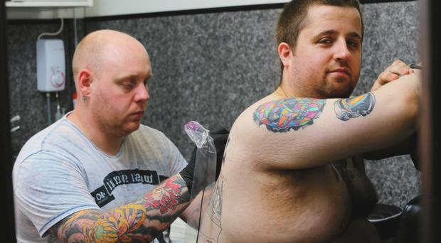 Signature piece: Tattooist Tom Kerr works on John Pollock's Titanic tribute tattoo at Grayscale Tattoo in Belfast