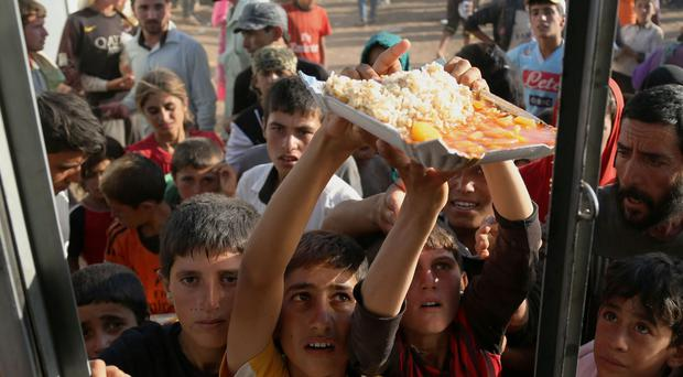 Human tragedy: Iraqi refugees receive food the way countries have been given arms by the West