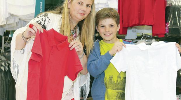 Shopping around: Teo Knox and his mum Karen check out uniforms at Sainsbury's