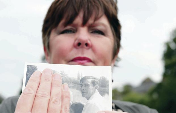 Painful memory: Cathy McCann with a photograph of her father John