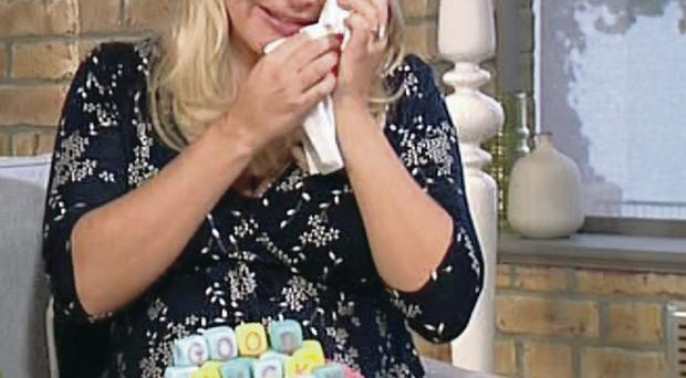Difficult balance: Holly Willoughby broke down as she left This Morning to have her third child