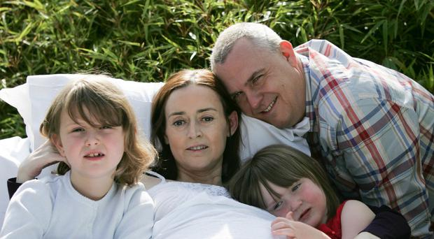 Andy and the girls share a tender moment with their mum Karen in the Hospice garden