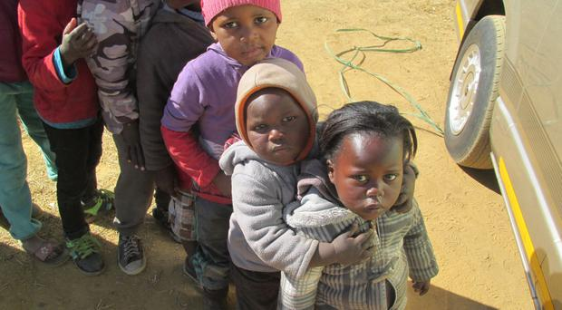 Quiet dignity: children in Johannesburg queue up for food