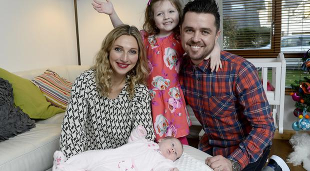 Pete Snodden with his wife Julia, daughter Ivana and newborn baby Elayna at their home in Bangor