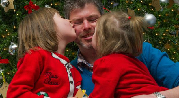 Family first: Richard Hood with daughters Rebekah and Megan at the Cancer Centre's Christmas tree
