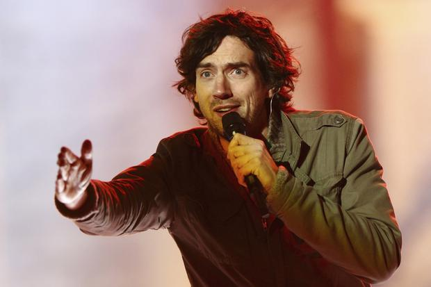 Frontman Gary Lightbody on stage with Snow Patrol