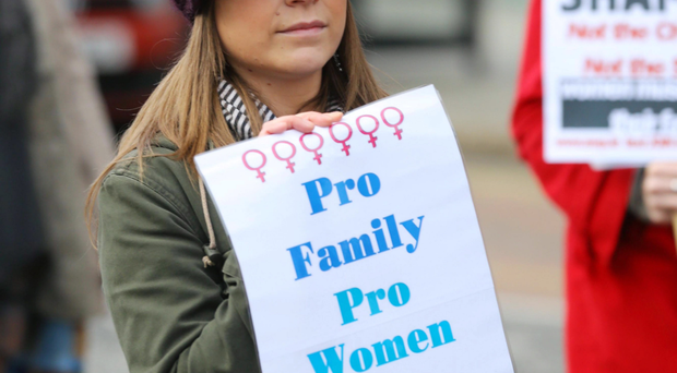 A pro-life demonstrator makes her feelings known on abortion