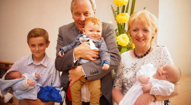 Child's play: grandparents Laurence and Eileen White with (from left) baby James, Ciaran, Ollie and Joseph