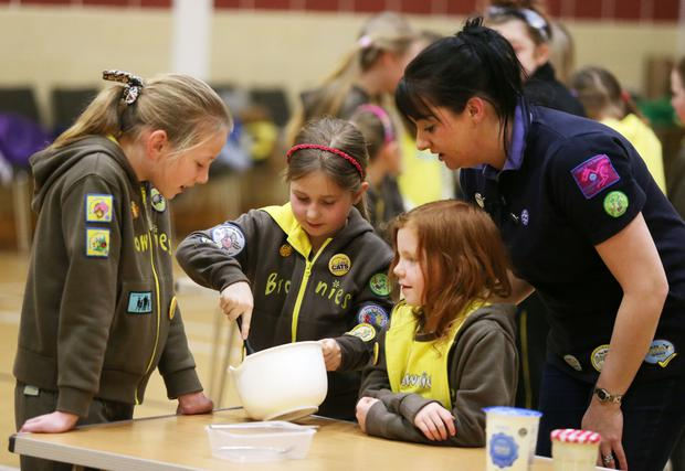 Causing a stir: The Royal Institution films the Girl Guides at the Jethro Centre in Lurgan conducting an experiment to change cream into butter