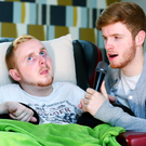 Song of hope: Mark McMullan sings to his brother Declan, who takes great comfort from hearing his voice