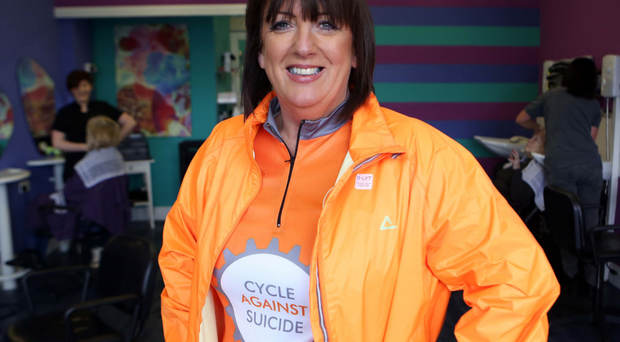 Chain reaction: stylist Monica Fee at her Drumahoe salon in full cycling gear