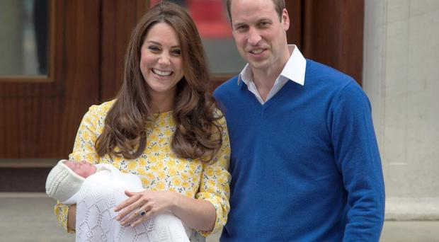 All smiles: the Duke and Duchess of Cambridge and the newborn Princess of Cambridge as they leave St Mary's Hospital in London